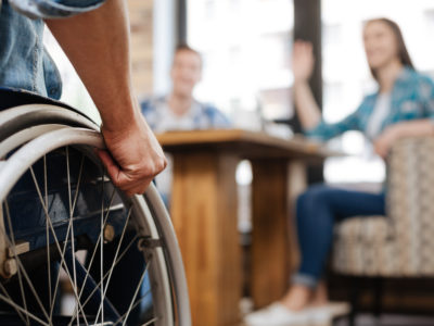 Confident handicapped man meeting his friends after a personal injury case. after a